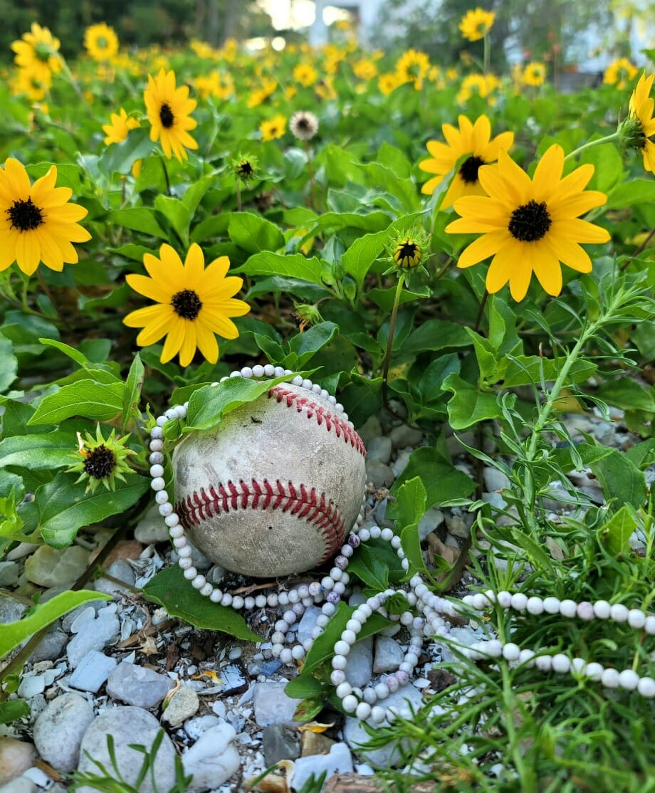 baseball and pearls in flowers