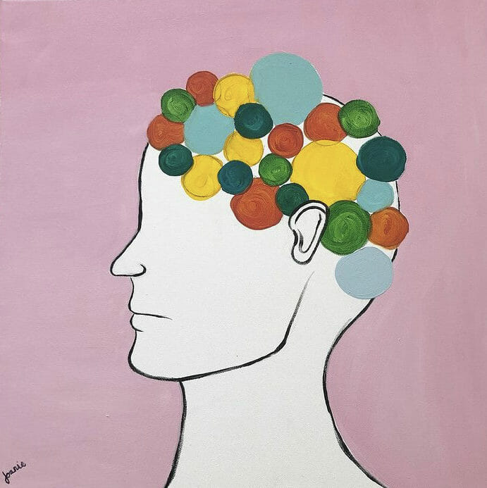 drawing of head with colored dots for hair